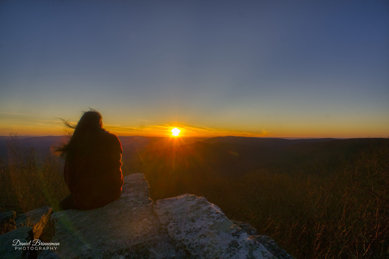 Lady faces a warm sunset at Bald Knob