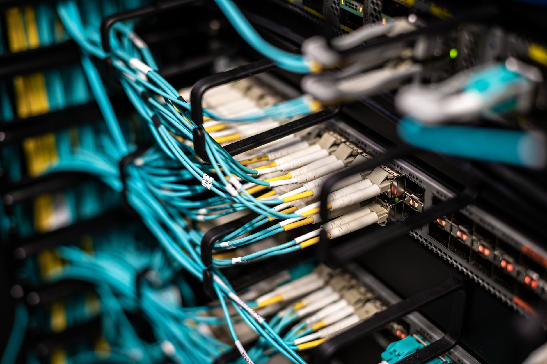 many cables plugged into patch panel